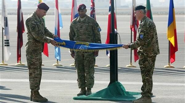 International Security Assistance Force Joint Command (IJC), Lieutenant General Joseph Anderson, left, folds the flag of IJC during a flag-lowering ceremony in north of Kabul International Airport in Kabul, Afghanistan, Monday, Dec. 8, 2014. (AP Photo)
