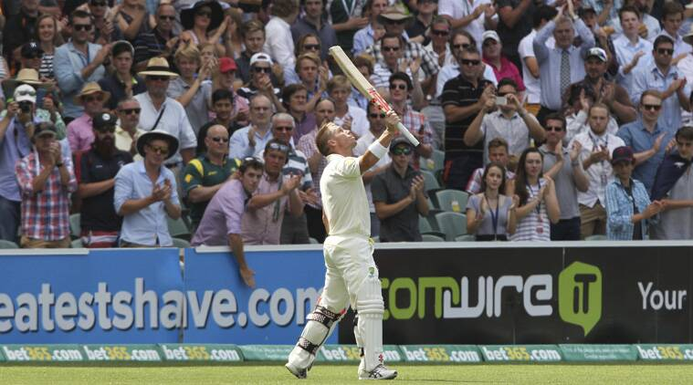 Warner stopped to look up when on 63 and embraced Michael Clarke after making his century as well. (Source: AP)