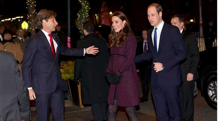 Kate, center, Duchess of Cambridge and Britain's Prince William, right, are greeted by The Carlyle hotel manager Giovanni Beretta, Sunday, Dec. 7, 2014, in New York. (Source:AP)