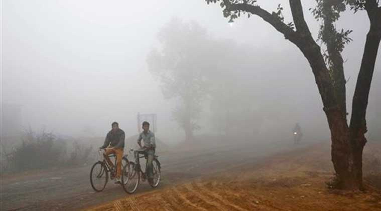Villagers cycle amidst fog early morning in Allahabad, India, Friday, Dec. 5, 2014. Several parts of north India are experiencing cold weather conditions. (Source: AP)