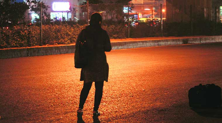 A woman commuter waits for her bus along the route taken by the victim of Dec 16, 2012 gangrape. (Source: Express photo by Oinam Anand)