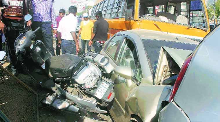 A school bus rammed into six cars and two other vehicles on SG Highway in Ahmedabad on Thursday. One student was injured. (Source: Express Photo by Javed Raja)