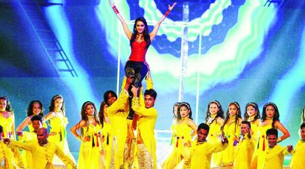 Dancers lift Kapoor during the act
