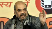 Shah sells Modi dreams, says once here, we stay