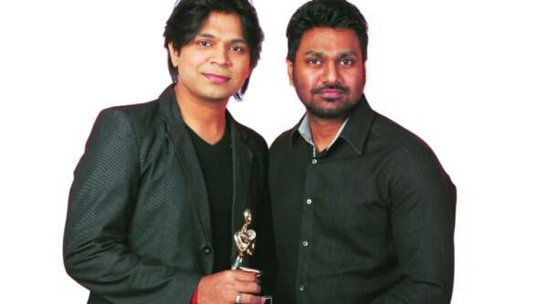 Ankit Tiwari and Mithoon  pose with their trophy