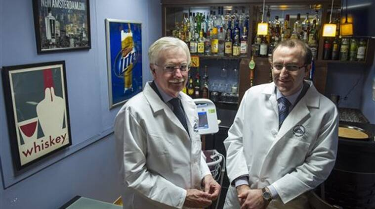 Dr. George Koob, director of the National Institute on Alcohol Abuse and Alcoholism, left, and NIAAA scientist Dr. Lorenzo Leggio pose for a photograph in a research laboratory designed as a bar inside the National Institutes of Health's hospital in Bethesda, Md. Leggio uses the lab to test how research volunteers react to a possible new way to curb heavy drinking, part of a broader hunt for more medications to help fight alcohol abuse. (Source: AP)