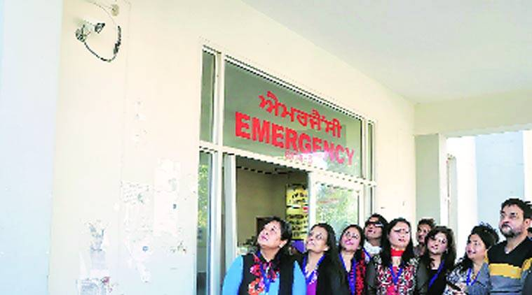 Members of the NGO with one of the CCTV cameras installed at the civil hospital.( Source: Express Photo by Gurmeet Singh)