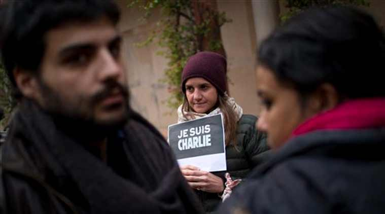 French journalists and their families show solidarity with the French satirical paper Charlie Hebdo at the French embassy in New Delhi (Source: AP)