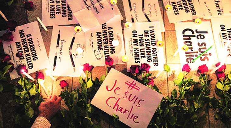 Messages and flowers at a memorial for the victims of the shooting in Paris. (Source: REUTERS )