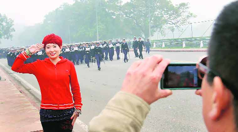 A foreigner poses for a photograph during Republic Day rehearsals near India Gate. (Source: Express Photo by Ravi Kanojia)