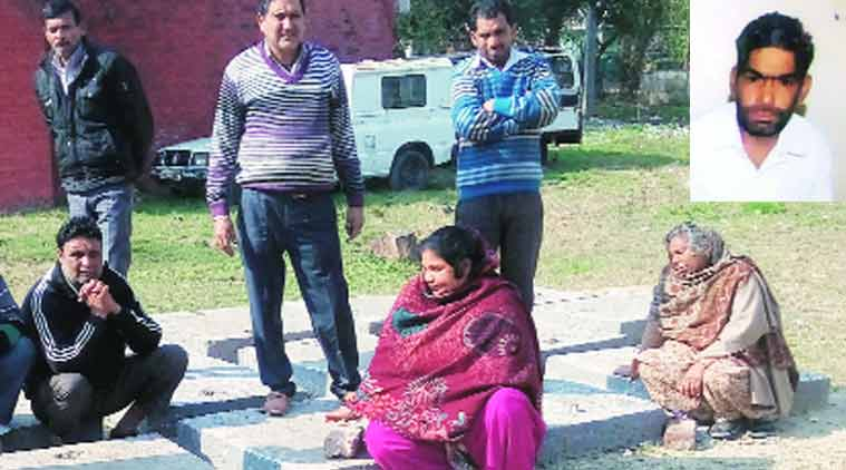 Family members of the victim (right) at the mortuary of General Hospital, Panchkula. (Source: Express Photo)