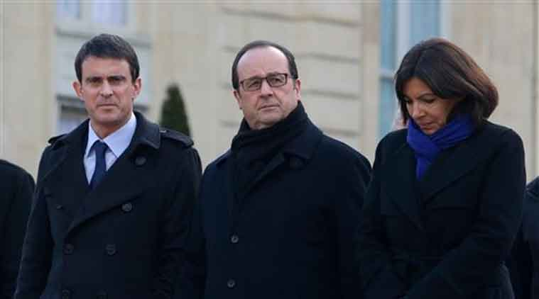 French President Francois Hollande, center, French Prime Minister Manuel Valls, left, and Paris Mayor Anne Hidalgo leave the Elysee Palace to board a bus to join a rally in Paris, Sunday. (Source: AP)