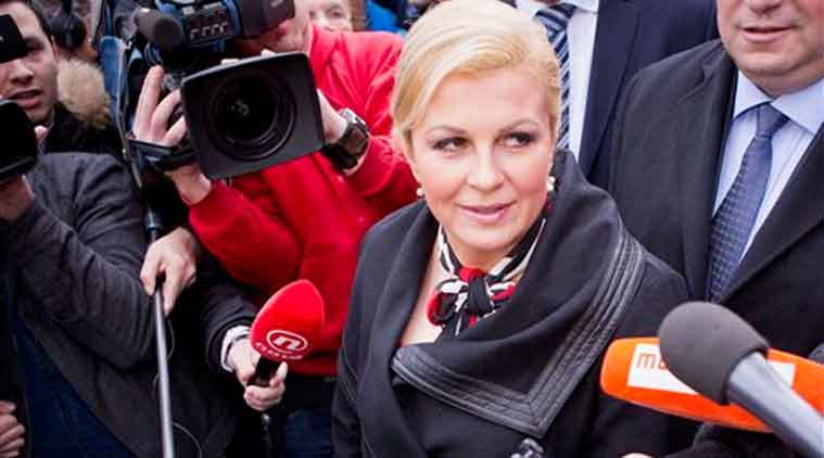 Conservative candidate Kolinda Grabar Kitarovic talks to the media outside a polling station in Zagreb, Croatia. (Source: AP)