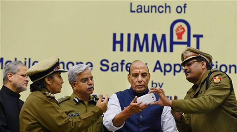 Home Minister Rajnath Singh with Delhi police Commissioner B S Bassi and Lt Governor Najeeb Jung during the launch of mobile phone based application 'Himmat' for the safety of women in the the capital, in New Delhi on Thursday. (Source: PTI)