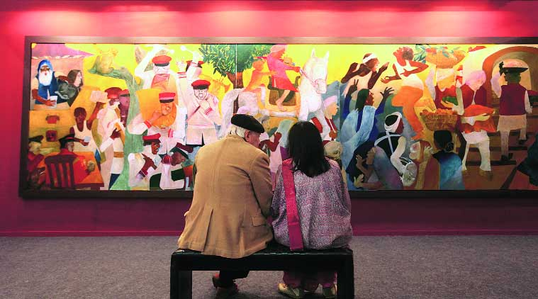 Artists Krishen Khanna and Anjoli Ela Menon at the India Art Fair. The painting is by Khanna. (Source: Express Photo by Oinam Anand)