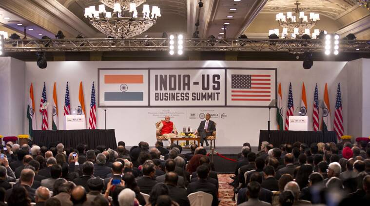 US President Barack Obama listens as PM Narendra Modi delivers a speech during the India-US business summit in New Delhi. (Source: AP photo)