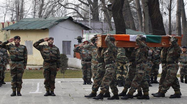 Indian Army soldiers carry a coffin of Indian army officer Col. M.N. Rai who was killed in a gunbattle Tuesday, at an army base in Srinagar, India, Wednesday, Jan. 28, 2015. (AP photo)