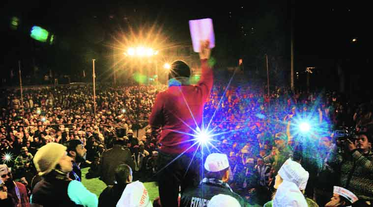 Arvind Kejriwal addresses a rally in Lal Bagh JJ colony. (Source: Express Photo by Ravi Kanojia)