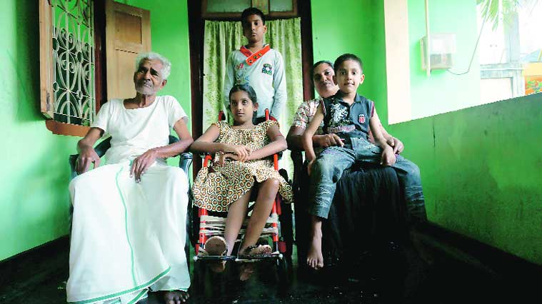 Gangadharan Mathivadani with her children and father. Her husband was killed and daughter paralysed in the bomb attacks on Mullaithivu. (Express photo by:  Arun Janardhanan)