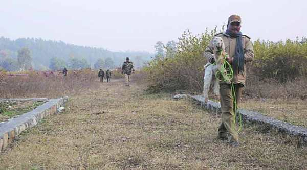 A forest official on way to tie a goat as a bait for the leopard in Dehradun. (Express Photo by: Virender Singh Negi)