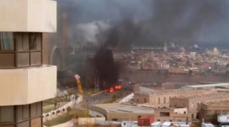 In this image made from video posted by a Libyan blogger, the Cortinthia Hotel is seen under attack in Tripoli, Libya, Tuesday, Jan. 27, 2015. (AP Photo/ @AliTweel via AP video)
