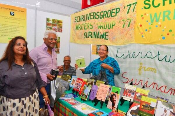 Professor Chan Choenni and his wife visiting the stall of the Writers; Group '77 Suriname in 2013 (right). Photo Credit: Ranjan Akloe (Hannabaran Media Production).
