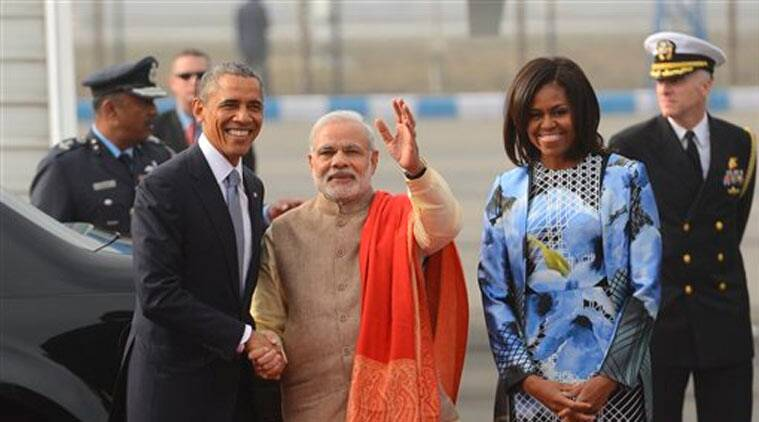 U.S. President Barack Obama shakes hand with Indian Prime Minister Narendra Modi, as first lady Michelle Obama stand beside them, upon arrival at the Palam Air Force Station in New Delhi, India, Sunday, Jan. 25, 2015. Obama's arrival Sunday morning in the bustling capital of New Delhi marked the first time an American leader has visited India twice during his presidency. Obama is also the first to be invited to attend India's Republic Day festivities, which commence Monday and mark the anniversary of the enactment of the country's democratic constitution. (Source: AP)