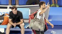 Murray sees off Dimitrov; Nadal also through