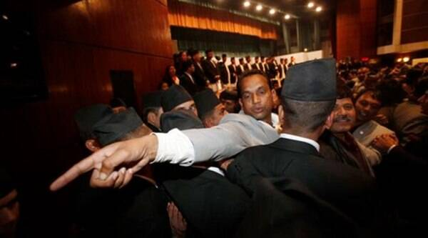 Nepalese security men form human chain to stop members of opposition parties to protest against the formation of a new constitutional draft, in Assembly hall, in Kathmandu. (AP Photo)