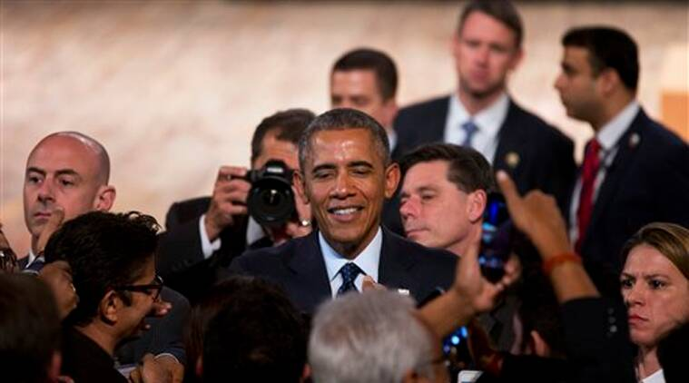 U.S. President Barack Obama interacts with the audience after delivering a speech at the Siri Fort Auditorium, a government-run event center, in New Delhi on Tuesday, Jan. 27, 2015. (AP Photo)