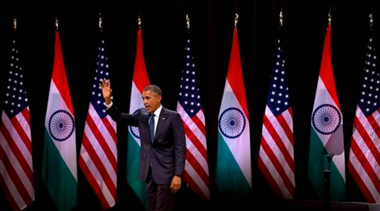 U.S. President Barack Obama waves to the gathering after delivering a speech at the Siri Fort Auditorium, a government-run event center, in New Delhi on Tuesday, Jan. 27, 2015. (AP Photo)