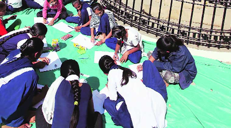 Schoolchildren participate in drawing competition organised to mark Mahatma Gandhi's death anniversary in Vadodara. (Source: Express Photo by Bhupendra Rana)