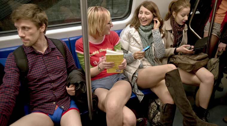 """Youngsters ride on a train as they take part in the first edition of the No Pants Subway Ride in Bucharest, Romania, Sunday, Jan. 11, 2015. The No Pants Subway Ride began in 2002 in New York as a stunt and has taken place in cities around the world since then. Organizers call it """"an international celebration of silliness"""" and are organizing it in dozens of cities on Sunday. (AP Photo/Vadim Ghirda)"""