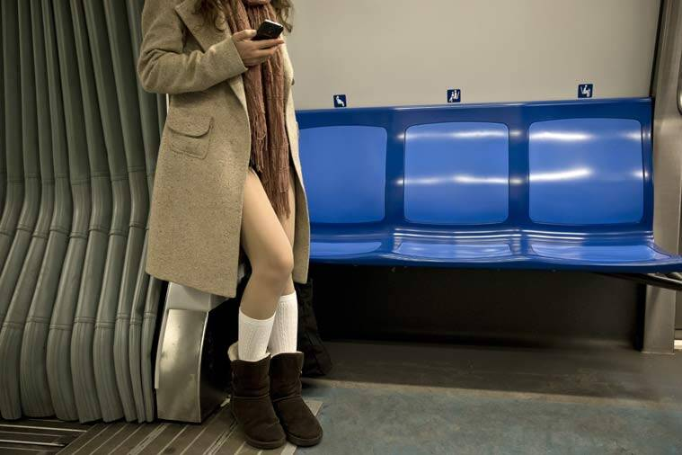 """A girl rides on a train as she takes part in the first edition of the No Pants Subway Ride in Bucharest, Romania, Sunday, Jan. 11, 2015. The No Pants Subway Ride began in 2002 in New York as a stunt and has taken place in cities around the world since then. Organizers call it """"an international celebration of silliness"""" and are organizing it in dozens of cities on Sunday. (AP Photo/Vadim Ghirda)"""