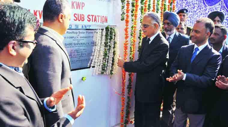 Shivraj V Patil inaugurates the solar power plant in Sarangpur. (Source: Express Photo by Sahil Walia)