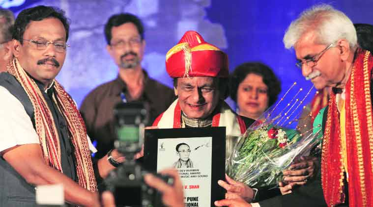 Education Minister Vinod Tawde confers the S D Burman International Award for creative sound and music on music director Anandji Shah. (Source: Express Photo by Arul Horizon)