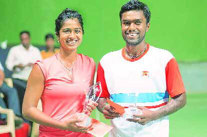 Prashanth and Sharmada Balu with the mixed doubles title at an AITA ranking tournament.