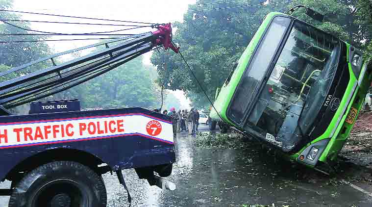 The bus being removed from the road. (Source: Express Photo By Jaipal Singh)