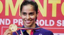 Saina defends Syed Modi title; Kashyap wins men's title
