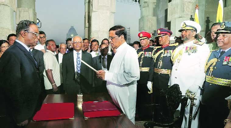 Sirisena takes oath as President in Colombo; Rajapaksa leaves the presidential residence. (Source: AP photo)