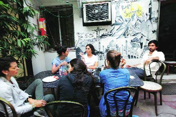 International tourists at Raj's Spanish Cafe (Express photo by Subham Dutta)