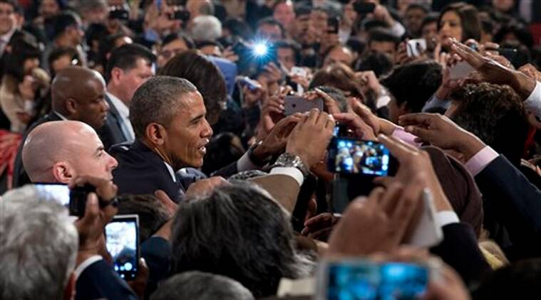 President Barack Obama greets people in the audience after speaking at the Siri Fort Auditorium in New Delhi on  Tuesday, Jan. 27, 2015. (AP Photo)