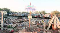 Mumbai Port Trust snaps out of slumber, slums wake up to bulldozers