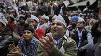 Riot of support for AAP in communal hot spots
