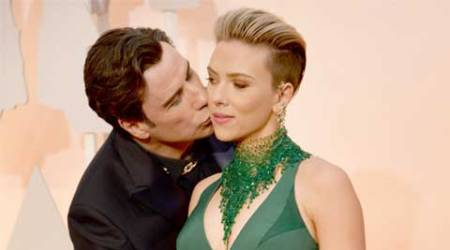 John Travolta's 'awkward' run-ins with Scarlett Johansson, Idina Menzel at Oscars
