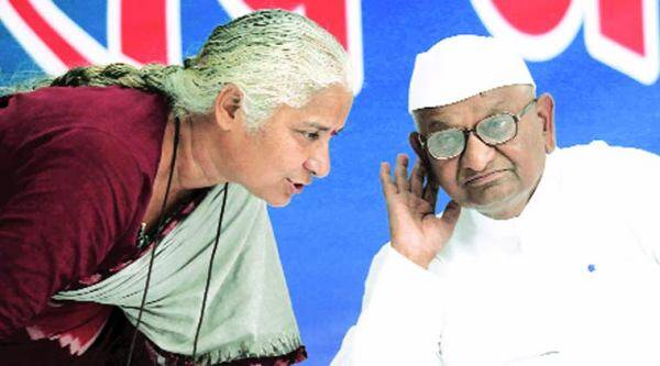 Anna with Medha Patkar on the first day of his protest at Jantar Mantar on Monday.(Source: Express Photo by Tashi Tobgyal)