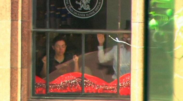 Herat said he contemplated stabbing Monis as Herat was forced to stand holding an Islamic flag against a cafe window.