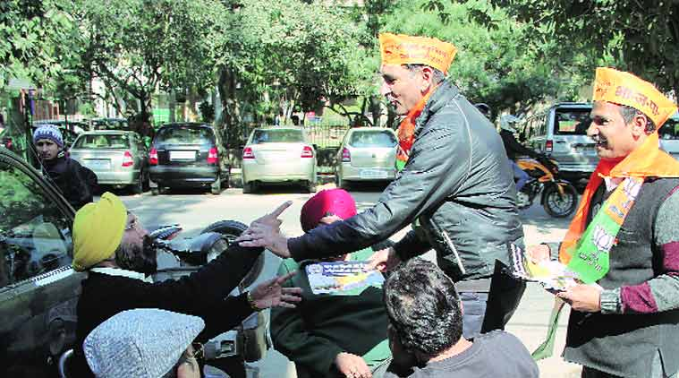 BJP workers campaign in Lajpat Nagar. (Source: Express Photo  by Gajendra Yadav)
