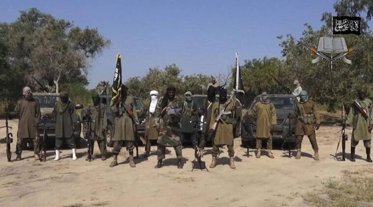 In this file image taken from video released on Oct. 31, 2014, by Boko Haram, Abubakar Shekau, centre, the leader of Nigeria's Islamic extremist group denies agreeing to any cease-fire with the government. (Source: AP File Photo)