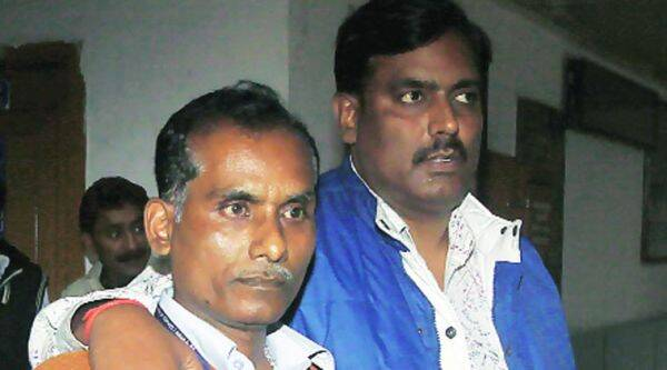 The accused in police custody on Monday.   (Prem Nath Pandey)